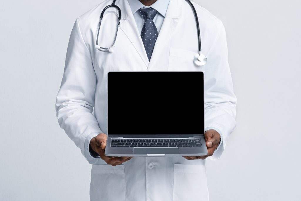 empty-laptop-screen-in-general-practitioner-hands-2XW63EB-scaled