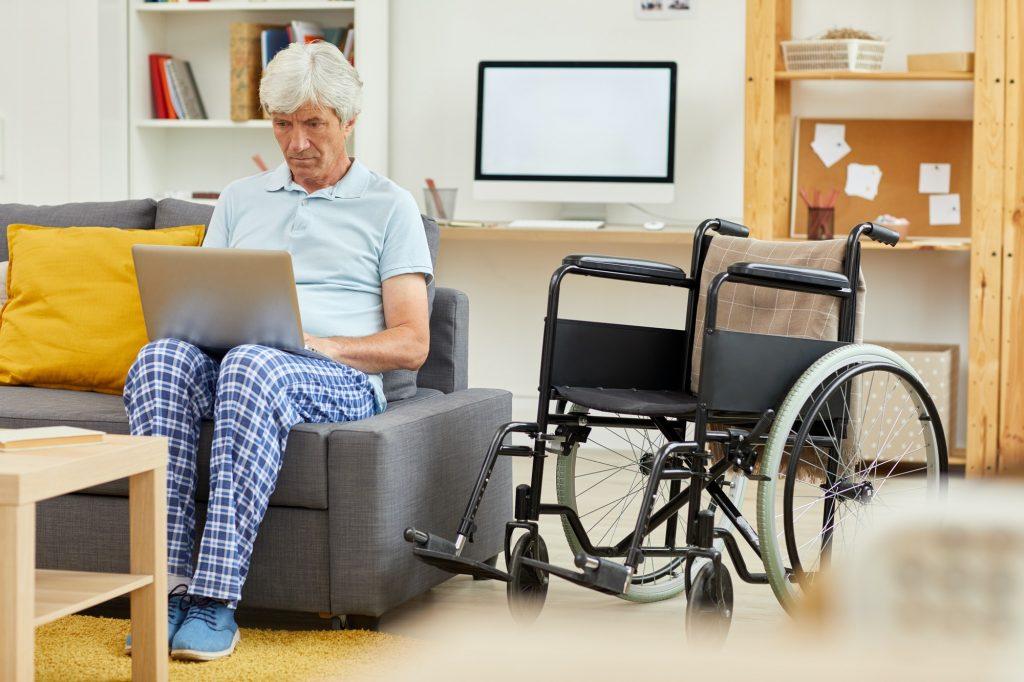Senior patient using on laptop